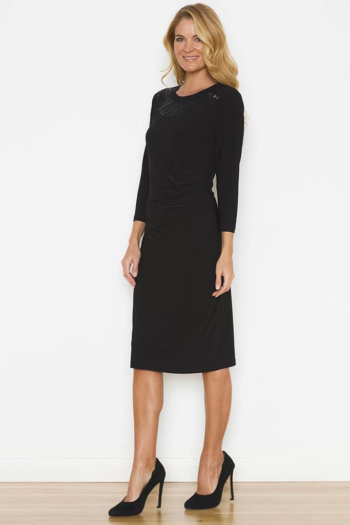 Noni B   SHANTI DRESS - Our Shanti Dress with bead detail is perfect for the working week or a fun night out! Pair perfectly with pointed heels and a fitted blazer for a classic tailored look.  Long sleeve Side gather Round neckline Bead neck detailing Fabric: Polyester/Spandex