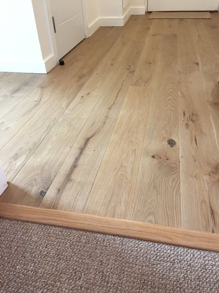 our beautiful light smoked engineered hardwood flooring meets carpet bespoke wood to carpet types