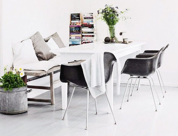 Bright Dining Room with Modern Chairs and Rustic Table