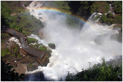 Ahhh...the heavenly waterfalls of Iguazu Falls in Cataratas, Argentina. Even God smiles upon it, check out the rainbow!