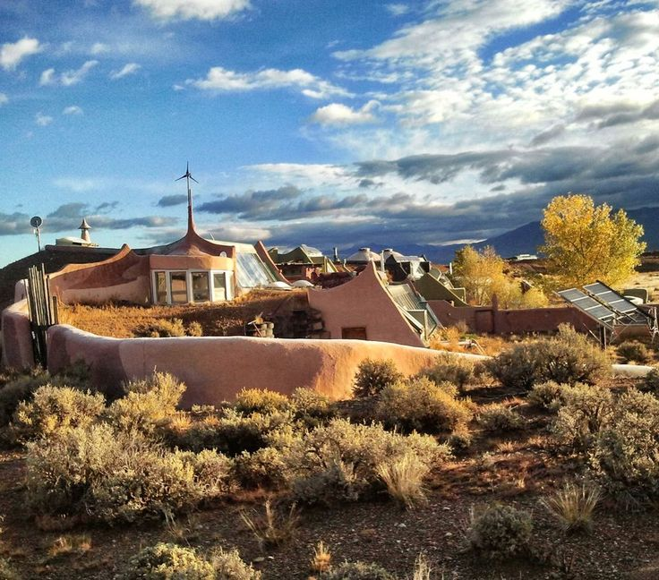 14 Earthship homes for sustainable, off-the-grid living. This house collects water, generates power and grows food.