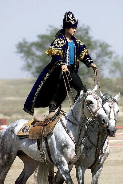 """""""A Kazakhstan performer demonstrates the long equestrian heritage as part of the gala concert during the opening ceremonies of Central Asian Pescekeeping Battalion (CENTRASBAT) 2000, Almaty, Kazakhstan,"""""""