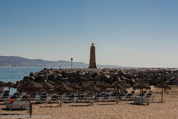 Beach at Puerto Banus with lighthouse