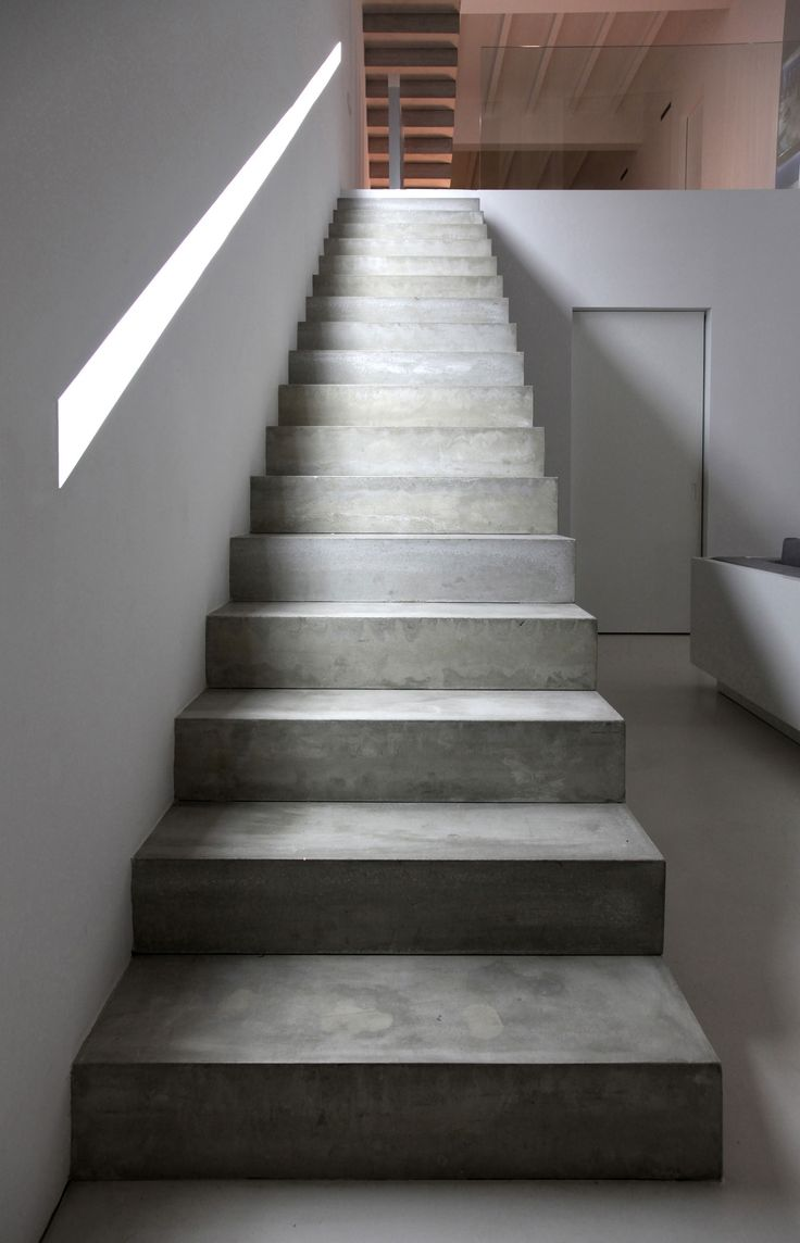 Alternating tread stair revit home design ideas - En The House Is Built Into A Housing Between Party And Has Five Floors The Core Of The Project Is A Large Open Space On The Ground Floor And A Sculptural
