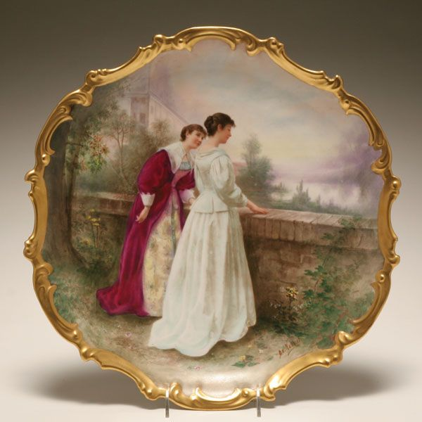 """Sevres hand painted porcelain portrait charger; 19th century painter D. E. Nerval portrays two elegant women conversing at a stone wall with estate beyond. Signed lower right and titled """"La Vue de Chateau"""" verso. 15 1/2"""" Diam. Good condition. - I WOULD HAVE LOVED THIS PLATE - IT SOLD FOR $400"""