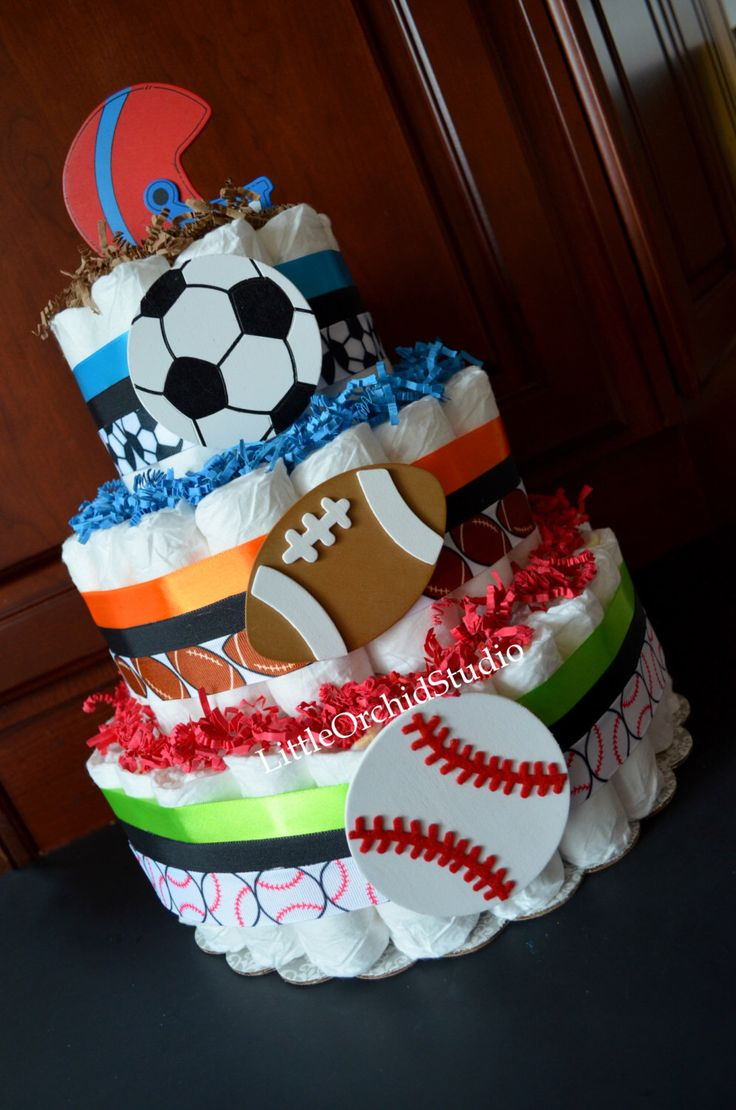 Sports Diaper Cake/ Boys Diaper Cake/ Baby Shower Center Pieces/ Baby Shower Decor/ Sports Theme/ Mommy To be/ Football Mom by LittleOrchidStudio on Etsy https://www.etsy.com/listing/226484039/sports-diaper-cake-boys-diaper-cake-baby