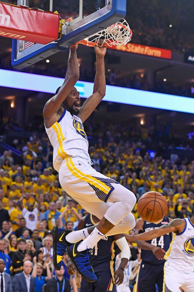 c5d368da6a0 Golden State Warriors  Kevin Durant (35) dunks the ball against the New  Orleans Pelicans during the second quarter of…