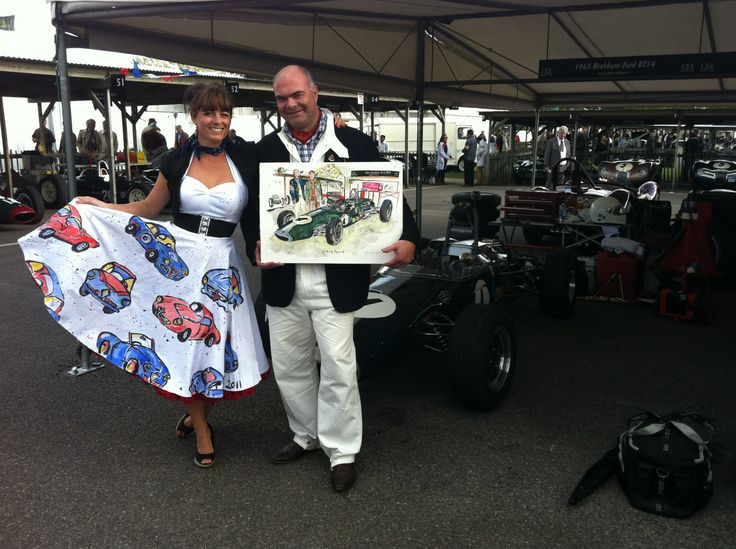 Anna-Louise with Matthew Newman and the painting of his car at Goodwood Revival in 2011 in her hand painted Vivien of Holloway dress
