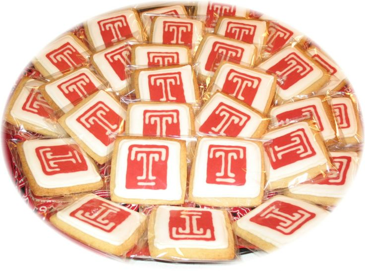 Temple University Logo Cookies - Nephew's HS Graduation Party. Attending Temple University next year so made logo cookies to go with his HS logo cookies (posted separately).  Toba's Butter Cookie, antonia74 outline/flood with chocolate transfer logo dropped on while wet.  TFL