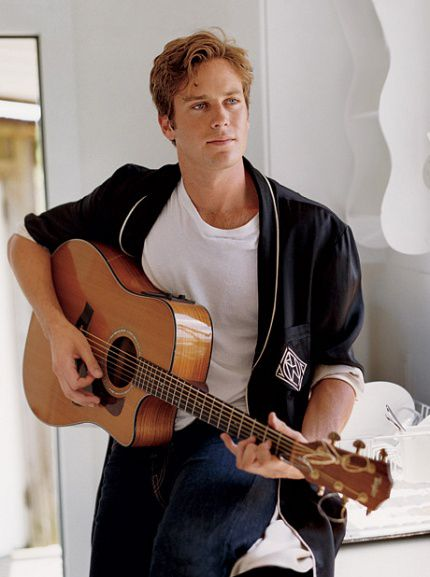 Oh no! Good-looking man with guitar--that's a lethal combination. Armie Hammer.