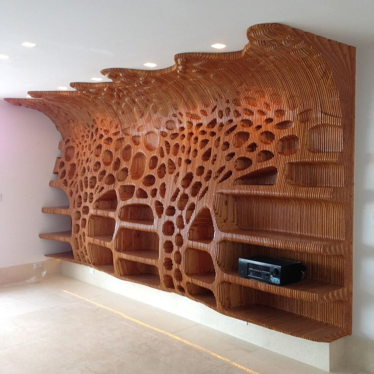 Wooden shelf in a private residence with the organic cellular formation and…
