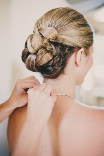 Beautiful braided and tucked updo: http://www.stylemepretty.com/2013/01/23/estes-park-wedding-from-june-cochran-photography-della-terra-mountain-chateau/ | Photography: June Cochran - http://www.june-cochran.com/
