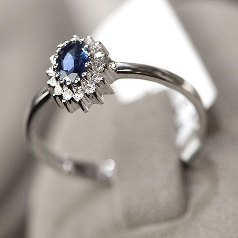 Saphire and diamond white gold ring. Like a miniature version of princess Kate's!
