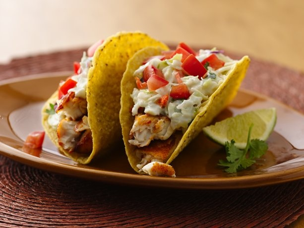 Spicy Fish Tacos with Fresh Lime Sauce... that are less than 300 calories a serving!