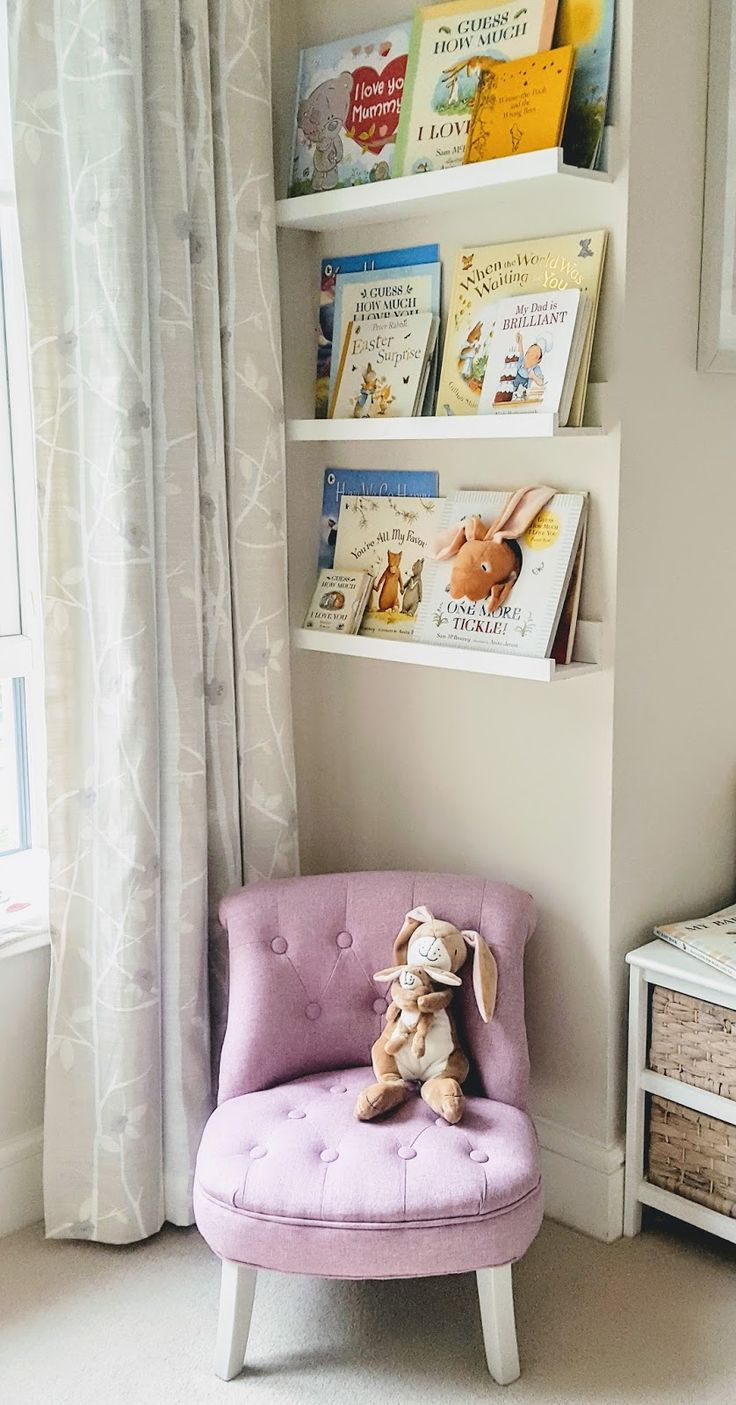 Library made from ikea picture ledges. Children's chair. Guess How Much I Love You. Nursery blog...