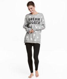 Pajamas in a soft cotton blend. Long-sleeved top in sweatshirt fabric in a longer style with ribbing at cuffs and hem. Leggings in soft jersey with elasticized waistband.