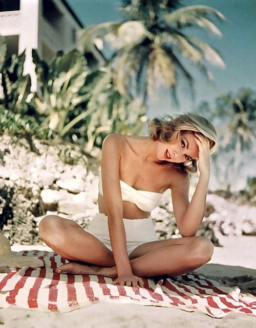 "vintagelite: ""Grace Kelly, beach side in Jamaica. photographed by Howell Conant, 1955 """