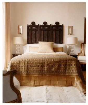 Moroccan Headboard  Rustic wood panels used as a headboard!  Very Marrakesh with the ...