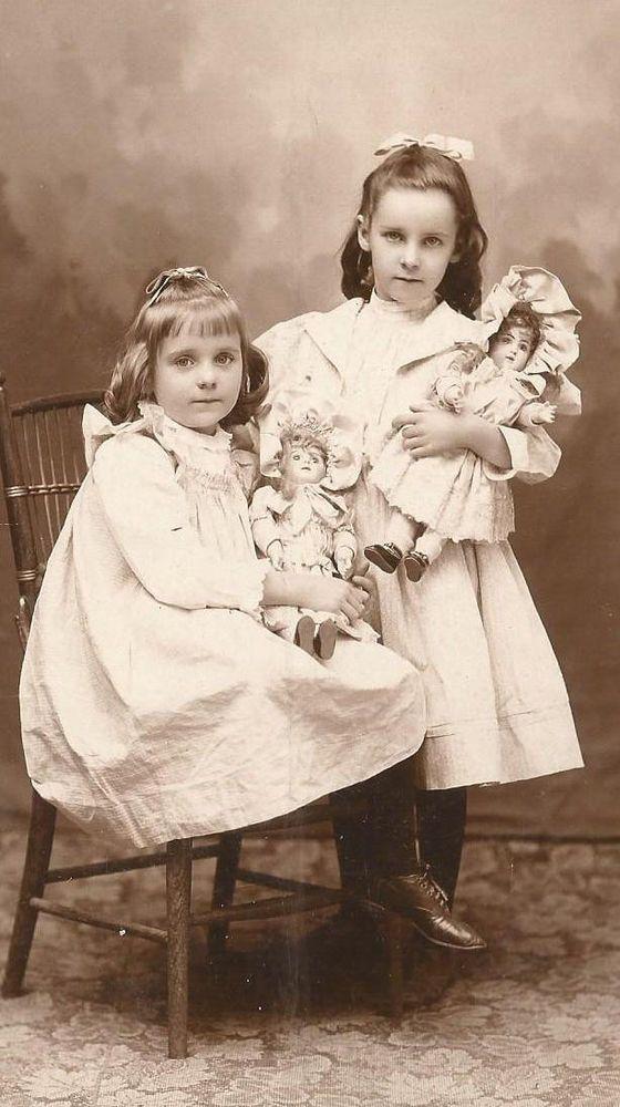 girls with their beloved dolls