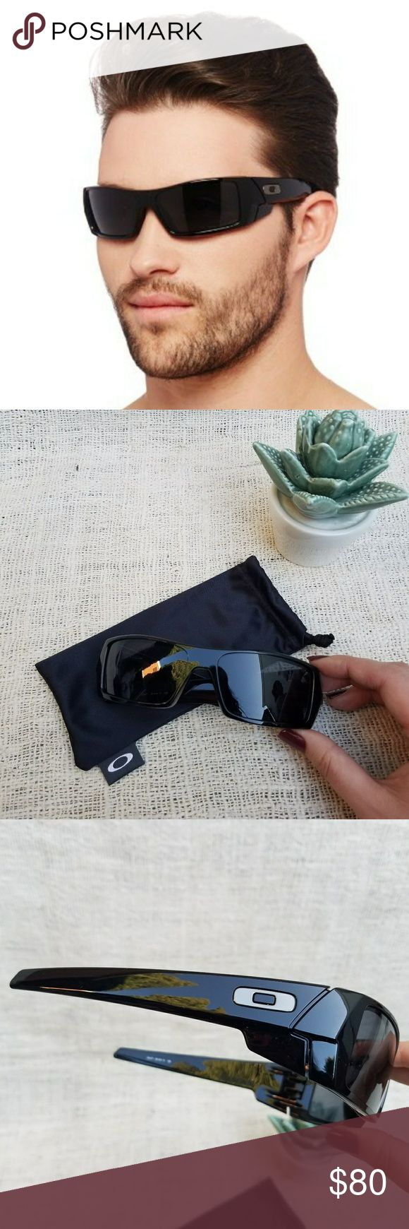 New Oakley Gascan Polished Black Sunglasses Inspired by the street glory of speed machines, Oakley® design language did a complete 180 in 2005. We traded soft curves for straight edges and hard lines to sculpt our very first high-wrap lifestyle shades. The toric lens design became known as Gascan® and it spawned an aesthetic so new and original, we customized our corporate logo for the frame.  New with microbag. Not polarized. Polished black frames with High Definition Optics (HDO) grey…