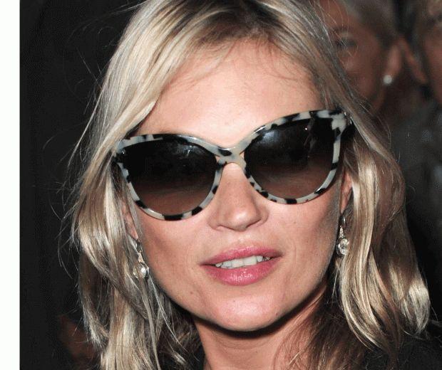 Kate Moss at Paris Fashion Week wearing cat-eye sunglasses