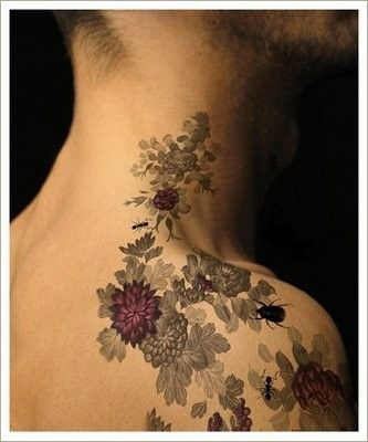 Such a beautiful tattoo. The gray tones with the splash of purple is wonderful. better on a woman i'd think