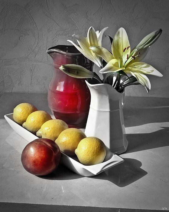 Classic  Still Life arrangement with pitchers, lemons and nectarine
