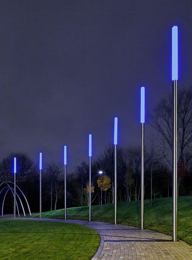 Bollards meet street lights to define a pedestrian via for Contemporary outdoor post light fixtures