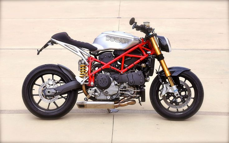 2004 Ducati 999S Cafe Racer Ducati Cafe Racer based on a 2004 Ducati 999S. This Ducati 999S Cafe Racer is named Red Devil 999 by Claudio Zanotto.  Ducati 999S Cafe Racer features Ducati cafe racer seat Custom Cafe racer clip-on handle bars Ducati Exhaust by Virex. 2004 Ducati 999S Cafe Racer 'Red devil 999' was a One of the attractive contestants at the Sun Ride icon award.