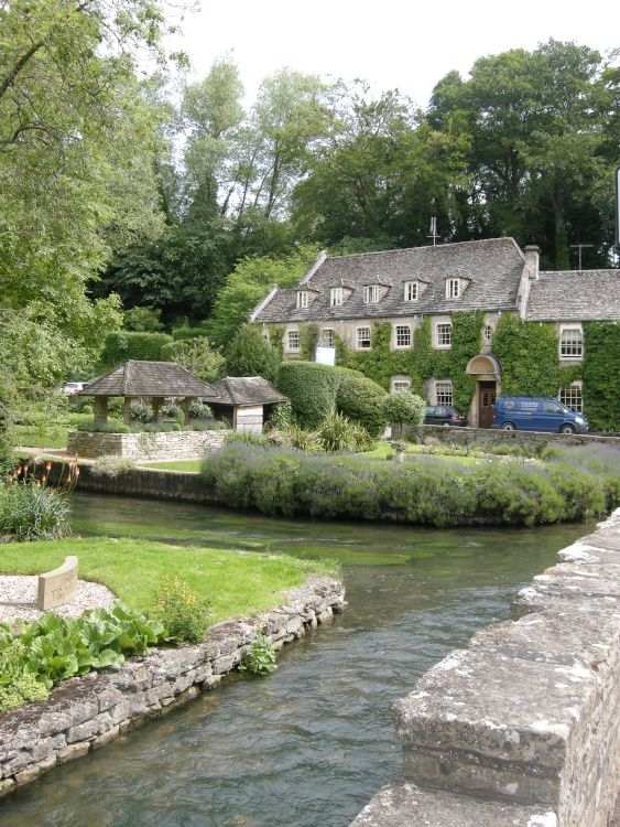 The gorgeous Cotswold village of Bibury, England, showing the Swan Hotel by B Lowe