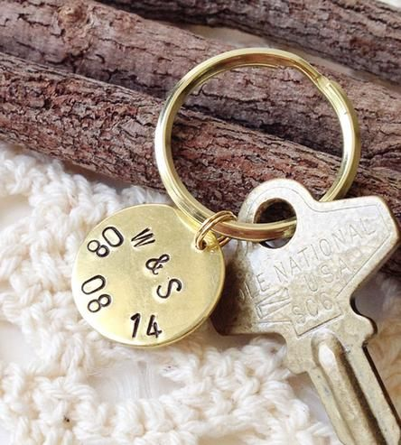 Commit the date to memory with this custom anniversary date key chain. The simple key ring features a circular brass charm, hand-stamped with both initials and the full date.