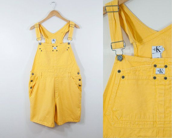 90s Vintage Calvin Klein jean overall shorts. Warm yellow tone. Silver hardware. Made in the USA. Circa: early 1990s Label: Calvin Klein, CK Jeans Size tag: Large Modern Size: Large (review measurements below to ensure a great fit) Fabric Content: 100% Cotton Care: