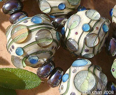 lina khan lampwork beads taganar ivory rounds with encased silver glass bellies