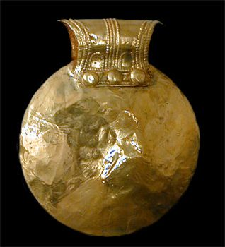 Bulla, a pendant worn by children to ward against evil.