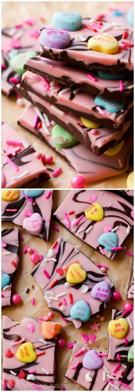 Super simple chocolate bark swirled with pink white chocolate and lots of candy hearts. Recipe on sallysbakingaddiction.com