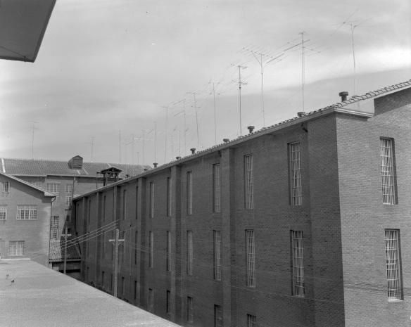 West wing of the Walls Unit on April 4, 1955 in Huntsville, TX.                                          To view a collection related to prisons in the Thomason Room and University Archives, click the link: https://archon.shsu.edu/index.php?utm_campaign=test150&utm_medium=referral&utm_source=pinterest&p=collections/controlcard&p=collections/controlcard&id=3