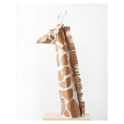 Tower over the rest with this surprisingly easy-to-make kid's Halloween giraffe costume.