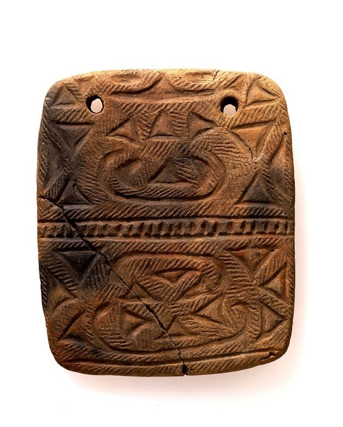 1,000-400 BC, Jomon period burial goods - pierced and carved clay tablet from Fukuda Shell Mound, Azuma-mura, Ibaraki. Japan. TOKYO NATIONAL MUSEUM