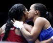 Brazil's Matos is kissed by Venezuela's Magliocco after Magliocco won their Women's Fly (51kg) Round of 16 boxing match during the London 2012 Olympic Games