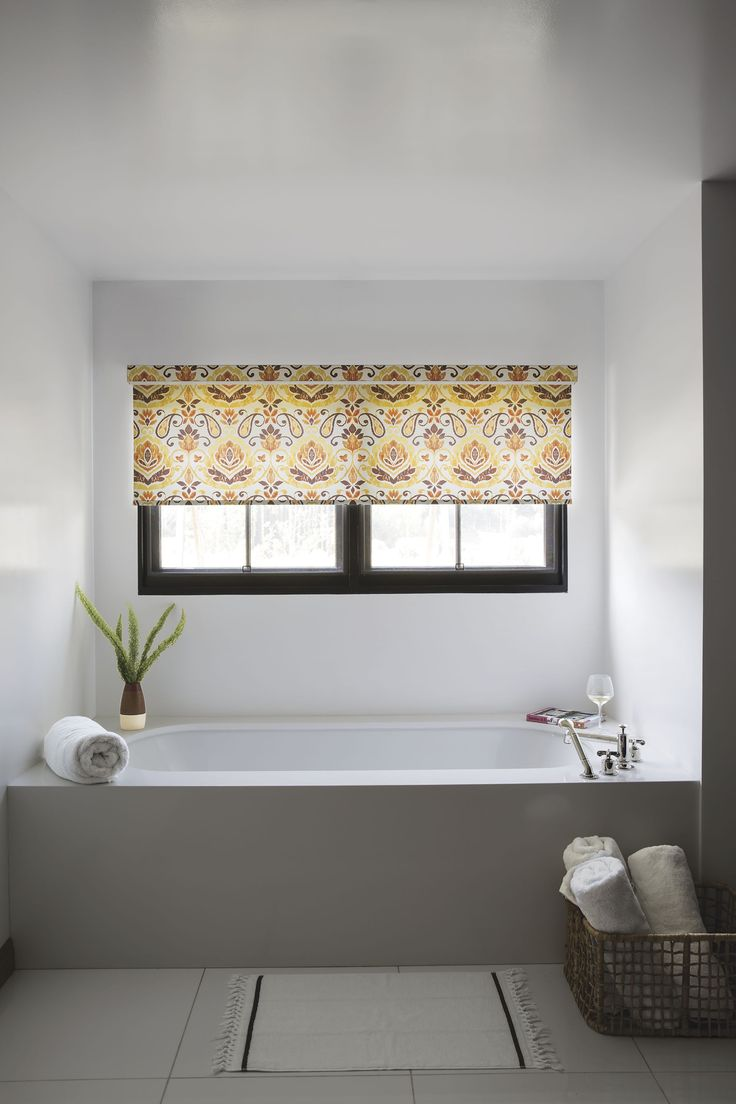 roller shades are a stylish way to keep bathroom windows covered they raise and lower