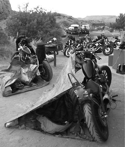"""""""There's a little Hot Spring outside Panaca, Nevada, where I went one morning to go swimming and there were a ton of bikers camping there, - it looked just like this - they were shooting guns and two of them got in a fight (the loser, a huge bearded biker, cried afterwards while two other bikers consoled him.)  Sweet Anarchy."""""""