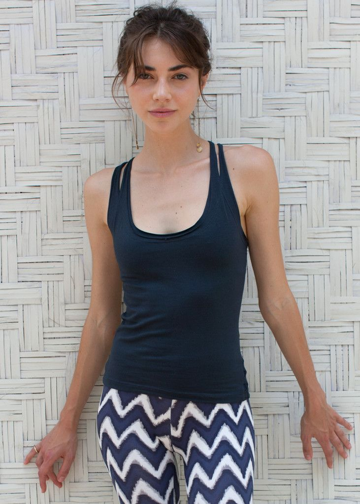 Amazing colour on this ethical yoga tank top from WE-AR. Superfine cotton knitted with a little elastane and a soft shelf bra for uplifting support. Cool double straps, with weaving detail. Check it out online on we-ar.com