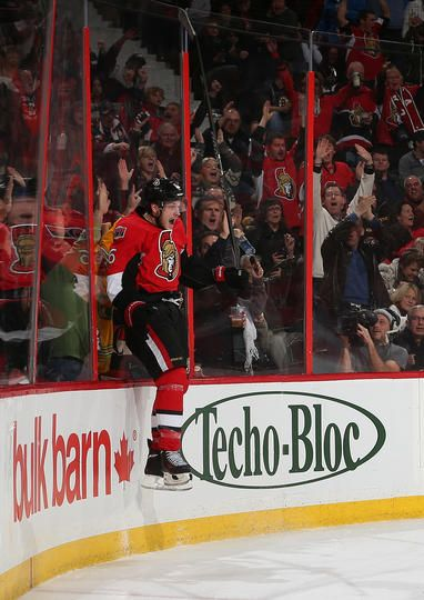 OTTAWA, ON - NOVEMBER 15: Bobby Ryan #6 of the Ottawa Senators jumps up against the glass to celebrate his third period goal against the Boston Bruins at Canadian Tire Centre on November 15, 2013 in Ottawa, Ontario, Canada. (Photo by Andre Ringuette/NHLI via Getty Images)