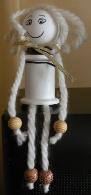 doll made from plastic thread spools