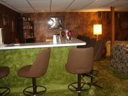 "some of us in the 70's had basements which were turned into ""rec rooms"" like this.   green shag carpet and bars"