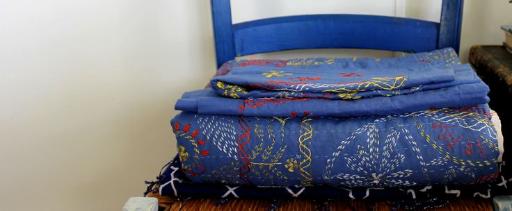 Hand embroidered quilt, made in Bangladesh.