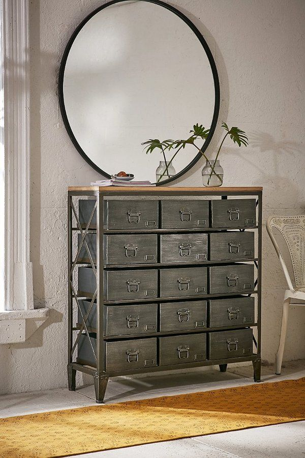 Industrial storage cabinet with a vintage-style finish. Tall and slim with a sturdy metal frame and smooth wooden top. With 15 drawers, there is plenty of storage.