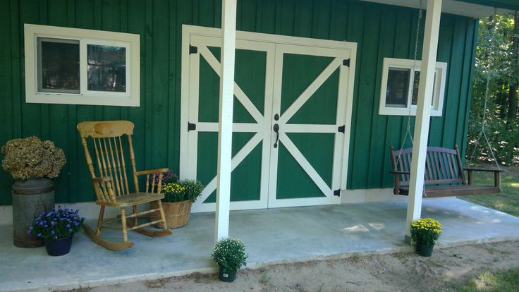 Enjoy the rocking chair or swing on the front porch of our garden barn.