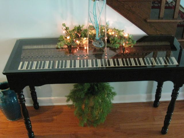 How beautiful, re-purposed part of an old piano into a table. I'd love to have one of these.