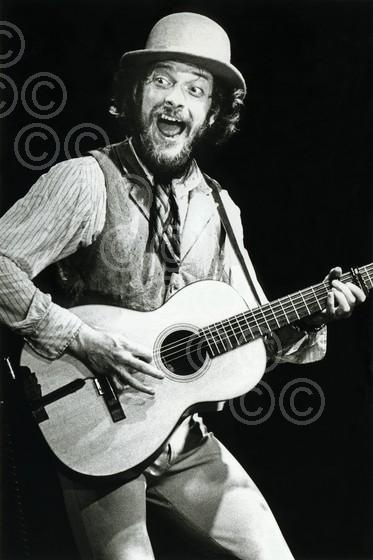 Ian Anderson  of Jethro Tull - known for his singing and flute playing, but also is adept at guitar, harmonica, mandolin, saxophone, drums and more.